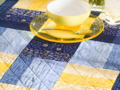 "The basics of quilting while making this 22"" x 58"" table runner."