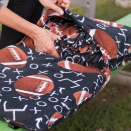 Stadium Cushion Double as a Tote for your Blanket